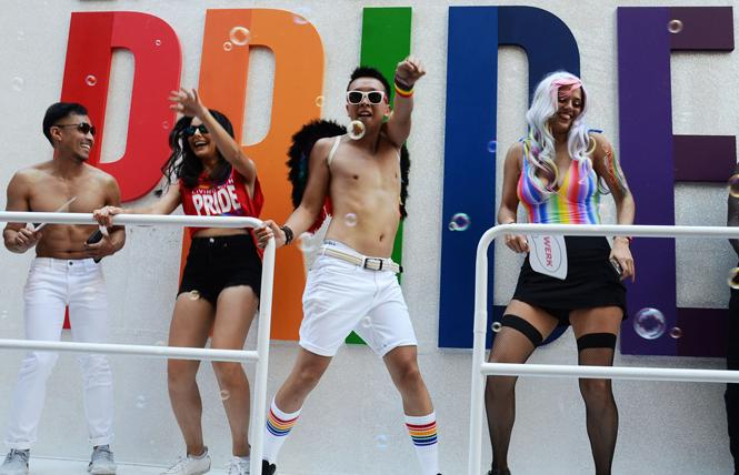 Dancers strut their stuff on a float in Sunday's San Francisco Pride parade. Photo: Rick Gerharter