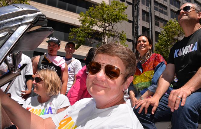Kamala Harris and her husband, Douglas Emhoff, rode in Sunday's San Francisco Pride parade. They were driven by Kris Perry, who was joined by her spouse, Sandra Stier. Harris married the women in 2013. Photo: Bill Wilson