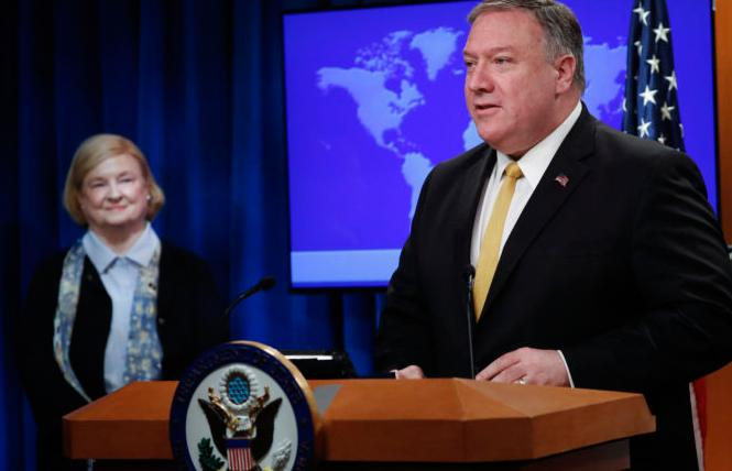 Secretary of State Mike Pompeo, right, unveils the creation of the Commission on Unalienable Rights, headed by Mary Ann Glendon, left, during an announcement at the U.S. State Department in Washington. Photo: Pablo Martinez Monsivais/AP
