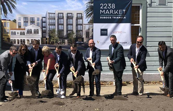 Helping to break ground at a new housing project on Market Street in the Castro were, from left, Don Bragg, Cindy Park, Bill Wenner, Michelle Andrighetto, Trey Clark, Alex Monaghan, Supervisor Rafael Mandelman, Dan Safier, Alex Fisher, and Gaurav Kapur. Photo: Matthew S. Bajko