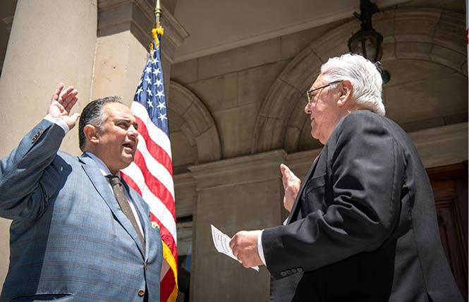 Gay former Assembly speaker John A. Pérez, left, was sworn is as chair of the UC Board of Regents July 1 by gay former state Democratic Party chairman Art Torres. Photo: Courtesy Twitter