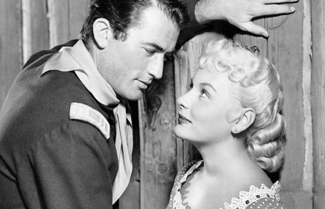 "Film stars Gregory Peck and Barbara Payton in the film ""Only the Valiant"" (1951)."