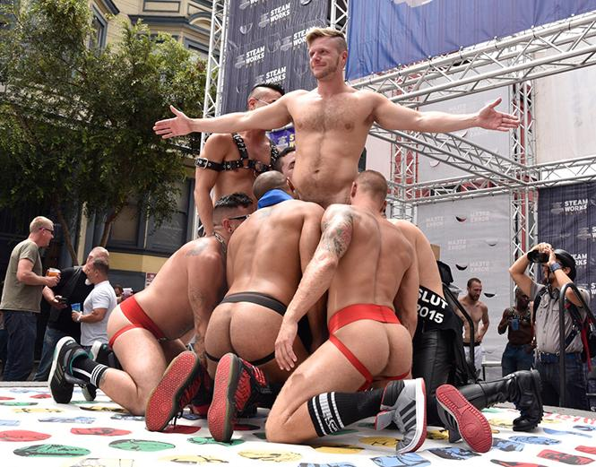 Porn actor Brian Bonds enjoys being king of Steamworks' Strip Twister game at the 2018 Up Your Alley Street Fair. photo: Steven Underhill