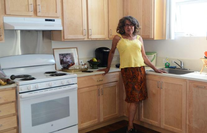 Donna Personna is thrilled with her new apartment at Openhouse's 95 Laguna Street senior housing complex. Photo: Rick Gerharter