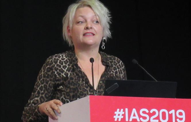 London researcher Dr. Laura Walters spoke during the IAS conference's closing session. Photo: Liz Highleyman