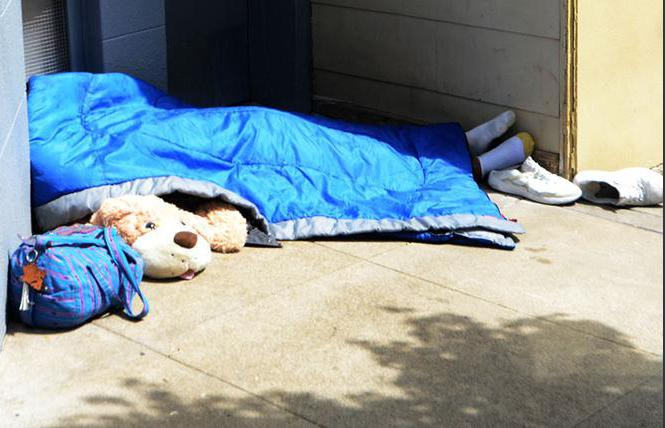 A man slept on a sidewalk in the Castro district in April 2018. Photo: Rick Gerharter
