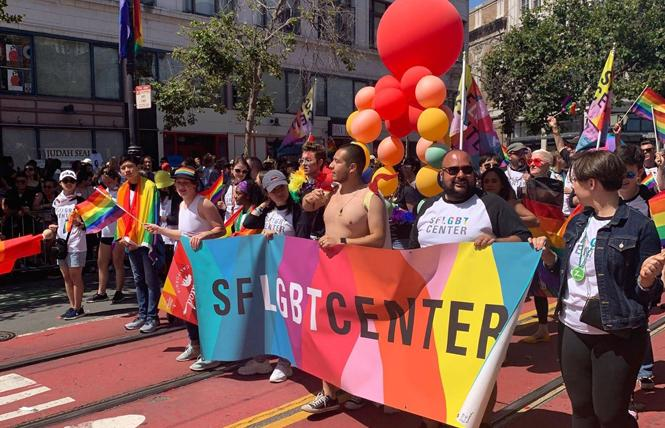 The San Francisco LGBT Community Center, shown here in June's Pride parade, has received nearly $61,000 from Plus Products for the sale of its cannabis-infused gummies. Photo: Courtesy SF LGBT center via Facebook