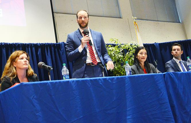 San Francisco district attorney candidate Chesa Boudin, second from left, speaks at a forum Tuesday at UC Hastings College of the Law. Other candidates, from left, are Suzy Loftus, Nancy Tung, and Leif Dautch. Photo: Rick Gerharter