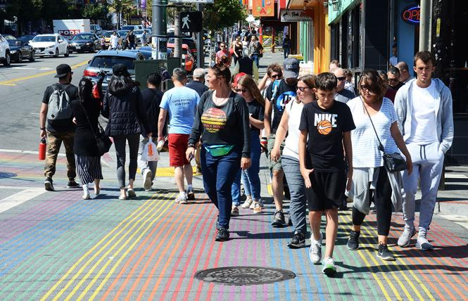 Shoppers and pedestrians cross at the intersection of Castro and 18th streets, one of the busiest in the neighborhood. Photo: Rick Gerharter