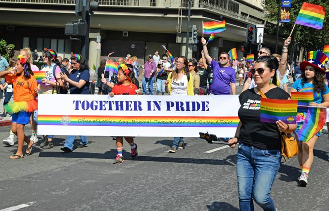 Maribel Martínez, right, director of the Santa Clara County Office of LGBTQ Affairs, marched with the office's contingent in the 2016 Silicon Valley Pride parade. Photo: Jo-Lynn Otto
