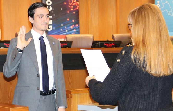 Glenna Wurm-Hayenga administered the oath of office to San Leandro Unified School District Trustee James Aguilar. She was his American Sign Language and leadership teacher at San Lorenzo High School. Photo: Courtesy James Aguilar