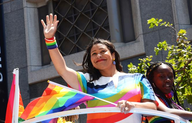 Mayor London Breed, shown here waving at spectators during the June Pride parade, was endorsed for a four-year term by the Alice B. Toklas LGBT Democratic club, while the Harvey Milk LGBTQ Democratic Club withheld its support. Photo: Rick Gerharter