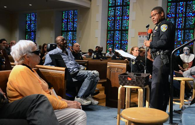 At an August 26 meeting at Glide Memorial Church, San Francisco Police Chief William Scott apologizes directly to Joanne Chadwick, left, for abusive treatment by the police department against the LGBTQ community. Chadwick attended the New Year's Eve party in 1965 at California Hall that was raided by the police and led to widespread criticism of the police department. Photo: Rick Gerharter