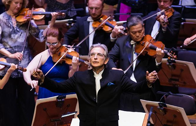 Michael Tilson Thomas leads the SFS Opening Gala audience in the National Anthem. Photo: Drew Altizer