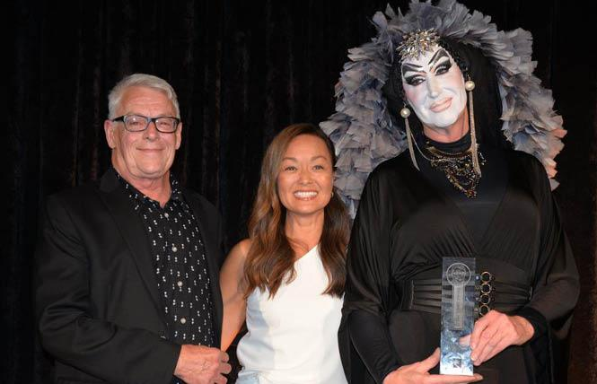 San Francisco AIDS Foundation board chair Mary Cha-Caswell, center, is flanked by Cleve Jones, who helped found the AIDS service organization, and honoree Sister Roma at SFAF's Tribute Celebration held September 7, just before the release of its new strategic plan. Photo: Bill Wilson