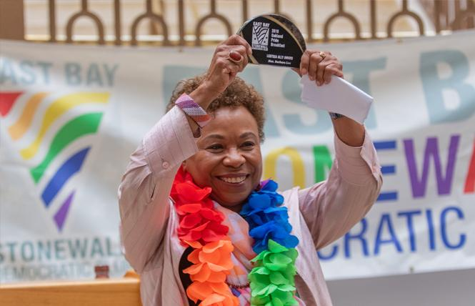 Congresswoman Barbara Lee holds the LGBTQIA Ally Award she received at the East Bay Stonewall Democratic Club's Pride breakfast Sunday in Oakland. Photo: Jane Philomen Cleland