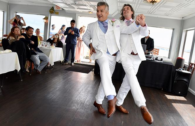 Newlyweds Carlos Eugenio Venturo Diaz-Copley, and Joseph William Copley-Venturo Diaz dance a one-step aboard the California Hornblower. photo: Steven Underhill