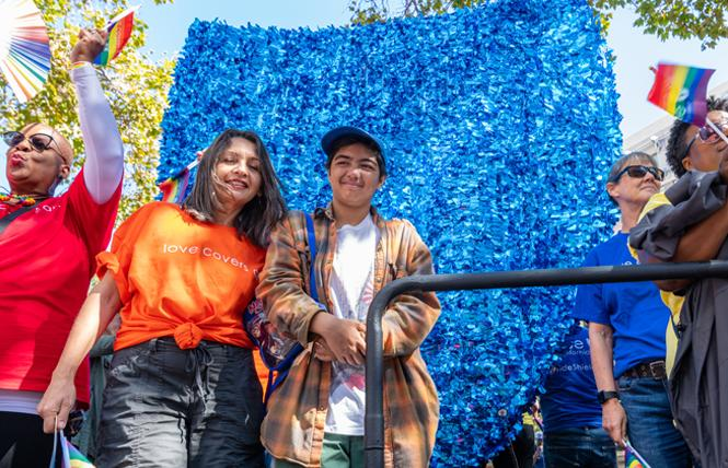 Angelica Matsuno, left, and her son, Rei, rode on the Blue Shield Pride float in the September 8 Oakland Pride parade. Photo: Jane Philomen Cleland