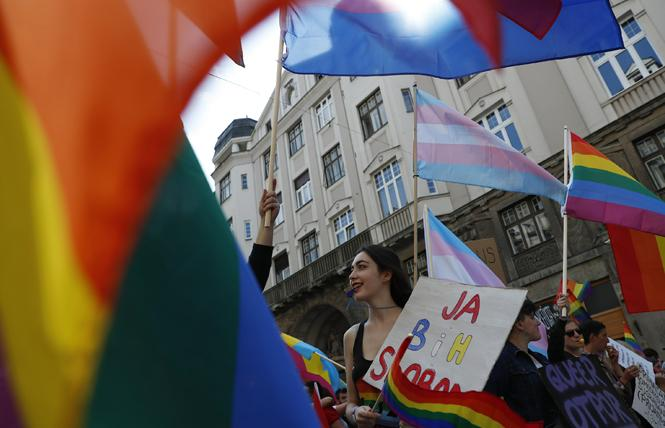 Pride marchers celebrate in the streets of Sarajevo for Bosnia's first successful Pride parade and celebration held September 8. Photo: Courtesy Associated Press
