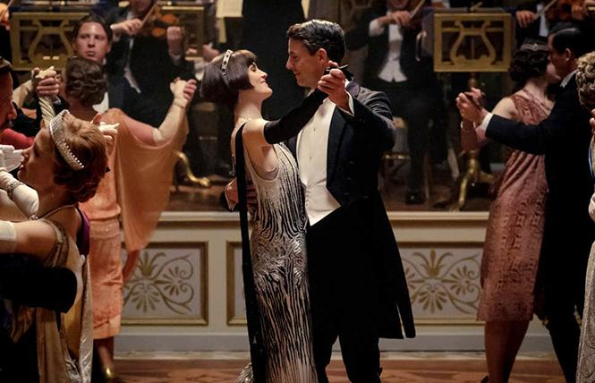 Michelle Dockery as Lady Mary Talbot (center left) and Matthew Goode as Henry Talbot in a scene from the film. Photo: AP