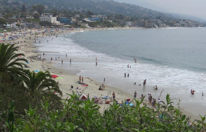 People enjoy Main Beach in Laguna Beach, as seen from cliff top Heisler Park. Photo: Charlie Wagner