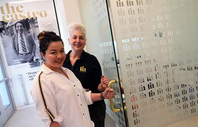 "TIN Rx Pharmacy co-owners Christina Garcia, left, and Patricia ""PJ"" Nachman enter the consultation room at their new pharmacy in the Castro. Photo: Rick Gerharter"