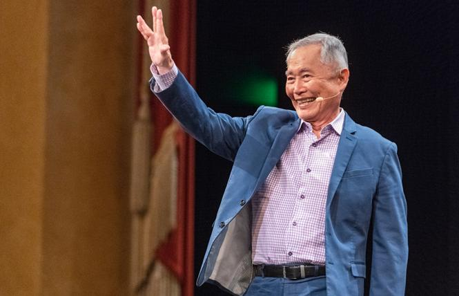 George Takei gives the Vulcan salute Tuesday during an appearance at the Commonwealth Club. Photo: Jane Philomen Cleland