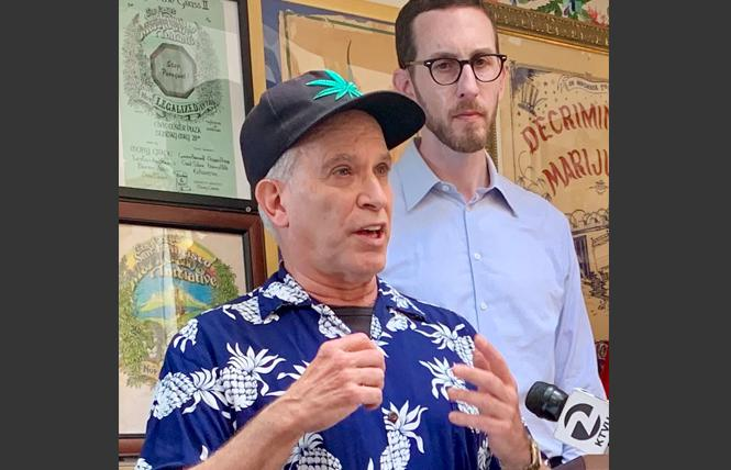 David Goldman, left, president of the Brownie Mary Democratic Club, spoke at a news conference with state Senator Scott Wiener about an indigent cannabis bill. Photo: Sari Staver