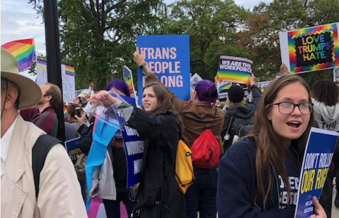 Supporters of LGBT rights gathered outside the U.S. Supreme Court Tuesday during historic oral arguments. Photo: Lisa Keen