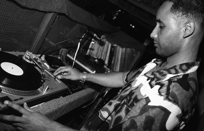 DJ Tim Luster spins the music at Club N'Zinga night at El Rio bar May 15, 1992. Photo: Rick Gerharter