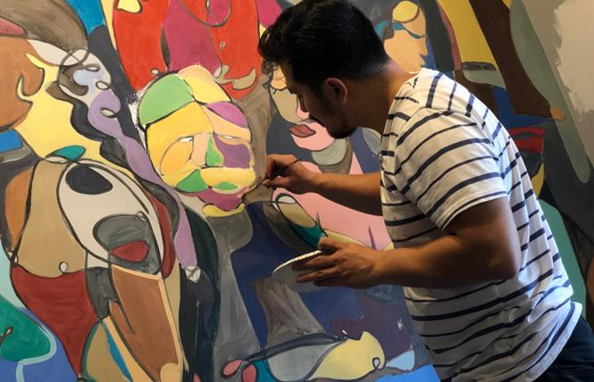 "Miguel Herrera paints a mural on the wall at Bhoga Restaurant & Bar Monday, October 7. The Castro Street ""progressive Indian"" restaurant is slated to open in mid-November. Photo: John Ferrannini"