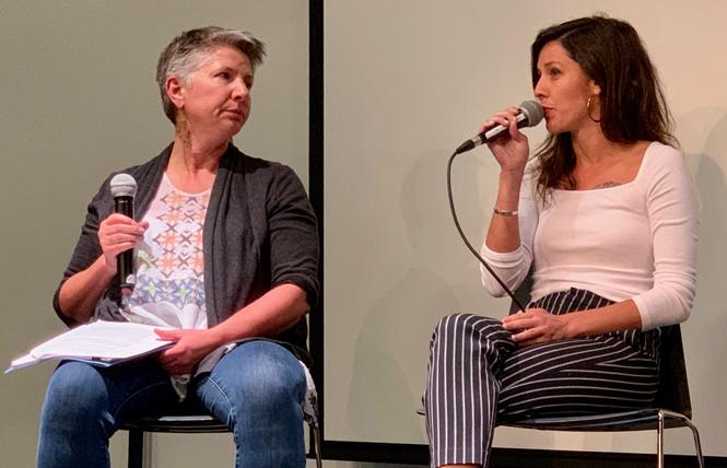 Jodi Schwartz, left, executive director of LYRIC, and Stephany Ashley of Brilliant Colors talk about the All In homeless campaign at an October 1 meeting. Photo: Sari Staver