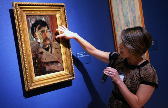 "Sarah Kleiner, a paintings conservator at the Fine Arts Museums, discusses painting techniques of James Tissot's ""Self Portrait,"" part of the exhibit ""James Tissot: Fashion & Faith"" at the Legion of Honor. Photo: Rick Gerharter"