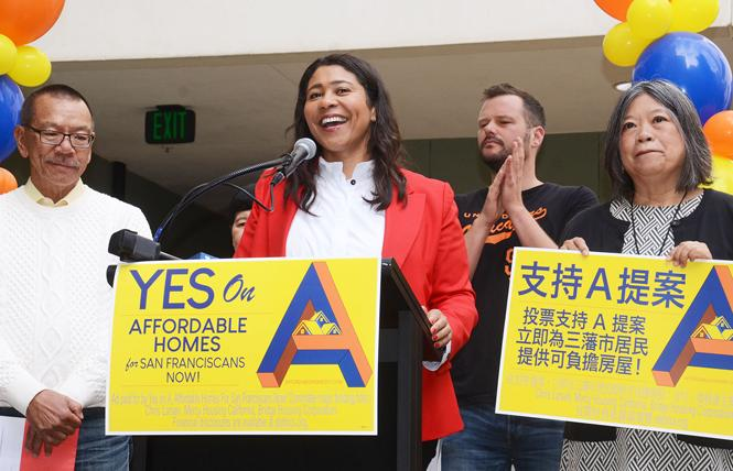 Mayor London Breed, center, joined by Supervisors Norman Yee, Matt Haney, and Sandra Lee Fewer, speaks to volunteers at the September campaign kickoff for Proposition A, a $600 million housing bond for San Francisco. Photo: Rick Gerharter