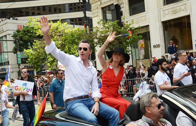 Governor Gavin Newsom, and his wife, first partner Jennifer Siebel Newsom, rode in this year's San Francisco Pride parade. Photo: Rick Gerharter