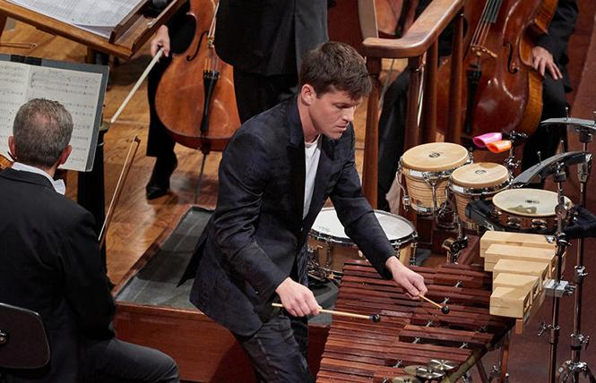 "SFS Principal Percussion Jacob Nissly performed the world premiere performance of Adam Schoenberg's ""Losing Earth"" with the San Francisco Symphony and Cristian M?celaru conducting. Photo: Stefan Cohen"