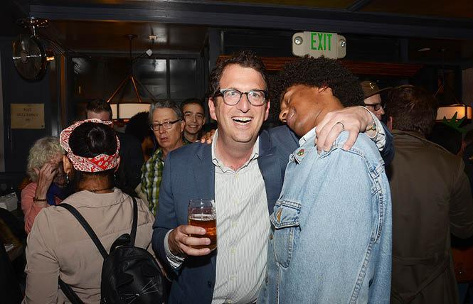 District 5 Supervisor candidate Dean Preston, left, gets a hug from supporter Basil Saleh at Preston's election night party in Hayes Valley. Photo: Rick Gerharter