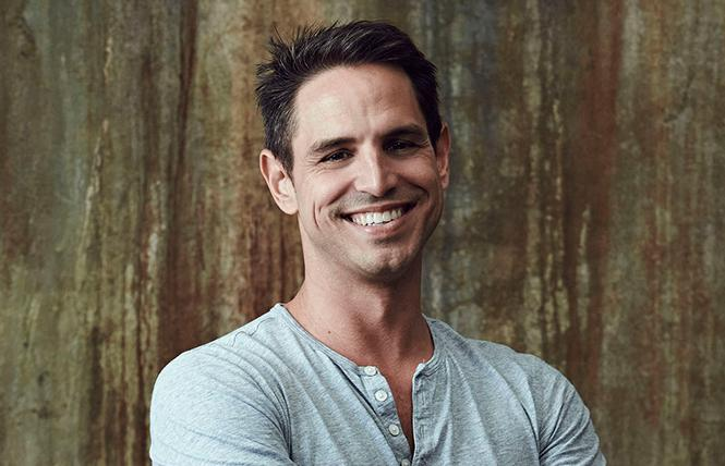 Arrowverse producer Greg Berlanti: his shows have all the queers, the first lesbian Batwoman and the first trans superhero. Photo: Courtesy of Warner Bros.