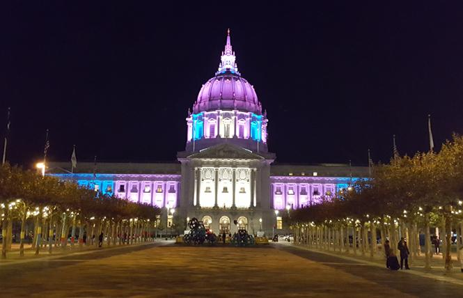 San Francisco City Hall is lit in the colors of the trans flag. Photo: Cynthia Laird