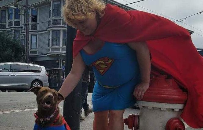 Shawn Sunshine Strickland, aka the Supergirl of San Francisco, pets a dog. Photo: Courtesy Donald Wagda