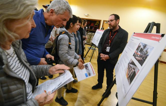 Noe Valley residents check out information on proposed changes to the J-Church Muni line at a community meeting Monday. Photo: Rick Gerharter