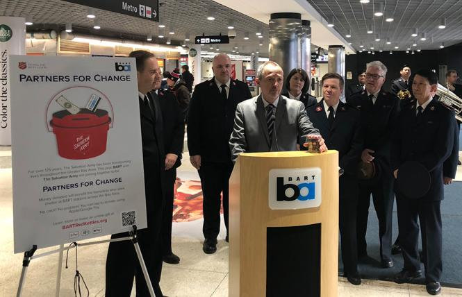 "BART board President Bevan Dufty speaks at the Powell Street station Tuesday to kick off the agency's ""Partners for Change"" initiative with the Salvation Army. Photo: Courtesy BART"