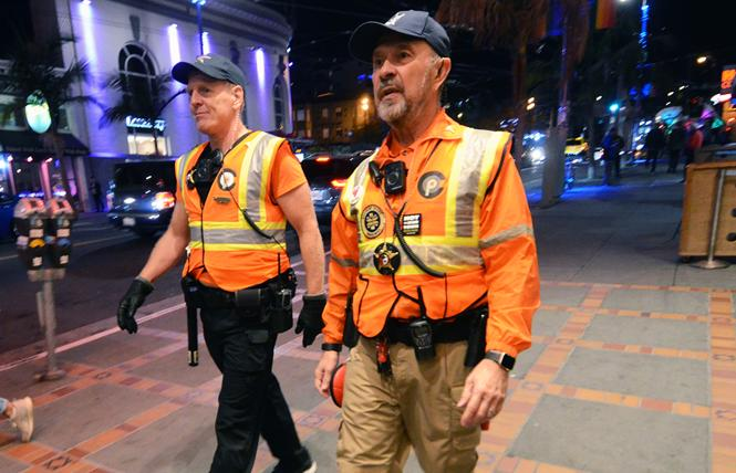 Castro Community on Patrol officers Brian Hill, left, and Greg Carey walk about the Castro neighborhood on a recent Friday night. Photo: Rick Gerharter