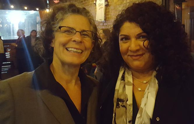 Elena Condes, left, a candidate for Alameda County Superior Court Judge, greeted Judge Delia Trevino at her kickoff event last week in Oakland. Photo: Cynthia Laird