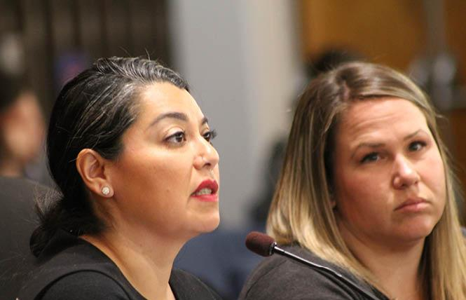 Maribel Martínez, left, and Alicia Anderson proposed increasing LGBT services in the South Bay during remarks to the Santa Clara County Board of Supervisors December 10. Photo: Heather Cassell