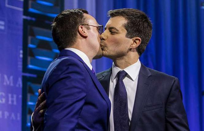 Pete Buttigieg kissing his husband Chasten was groundbreaking gay TV. Photo: AP