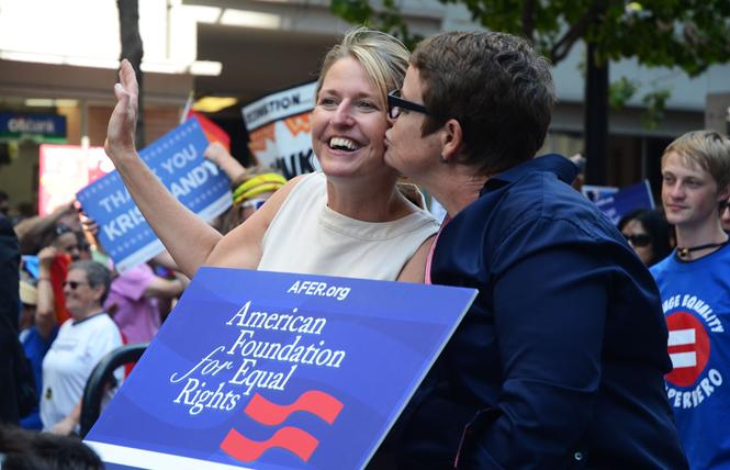 Proposition 8 plaintiffs Sandy Stier, left, and Kris Perry rode in San Francisco's Pride parade June 30, 2013, just days after they were married by then-state Attorney General Kamala Harris. Photo: Rick Gerharter