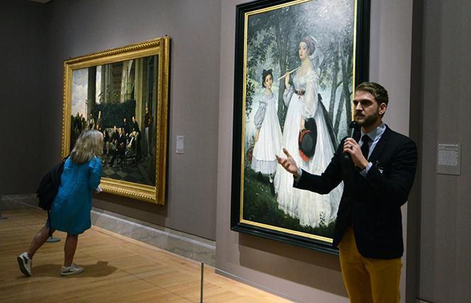 "Musée D'Orsay paintings curator Paul Perrin, co-curator of the exhibit ""James Tissot: Fashion and Faith"" at the Legion of Honor, discusses two paintings, ""The Circle of the Rue Royale"" and ""The Two Sisters: Portrait."" Photo: Rick Gerharter"