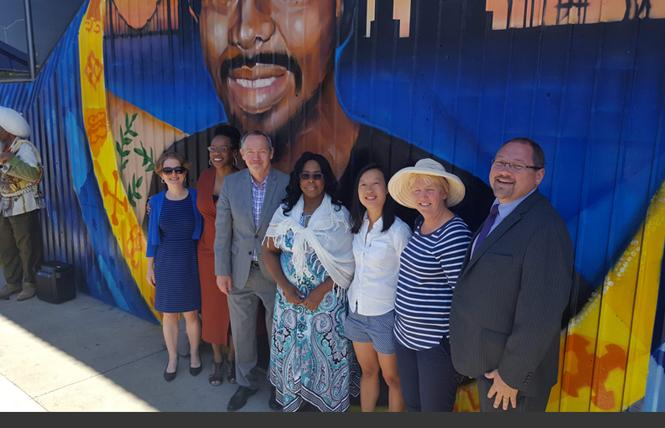 BART directors Rebecca Saltzman, left; Lateefah Simon; then-board President Bevan Dufty; Oscar Grant's mother, Wanda Johnson; and BART directors Janice Li; Liz Ames; and Mark Foley attended a June unveiling of the mural of Grant at the Fruitvale BART station, the site of Grant's killing by a BART police officer in 2009. Photo: Courtesy BART