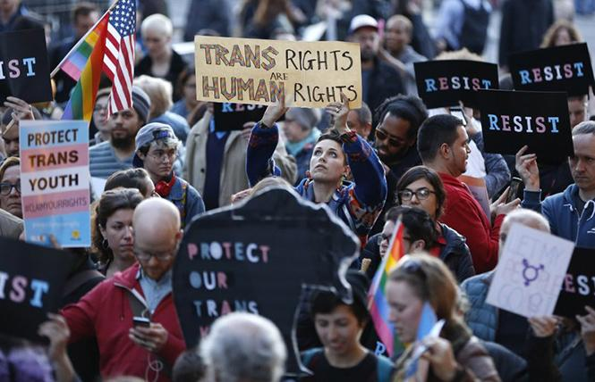 People rallied at the Stonewall National Monument in New York City in February 2017 to protest President Donald Trump's decision to roll back a federal rule saying public schools had to allow transgender students to use the bathrooms and locker rooms of their chosen gender identity. Photo: Courtesy AP